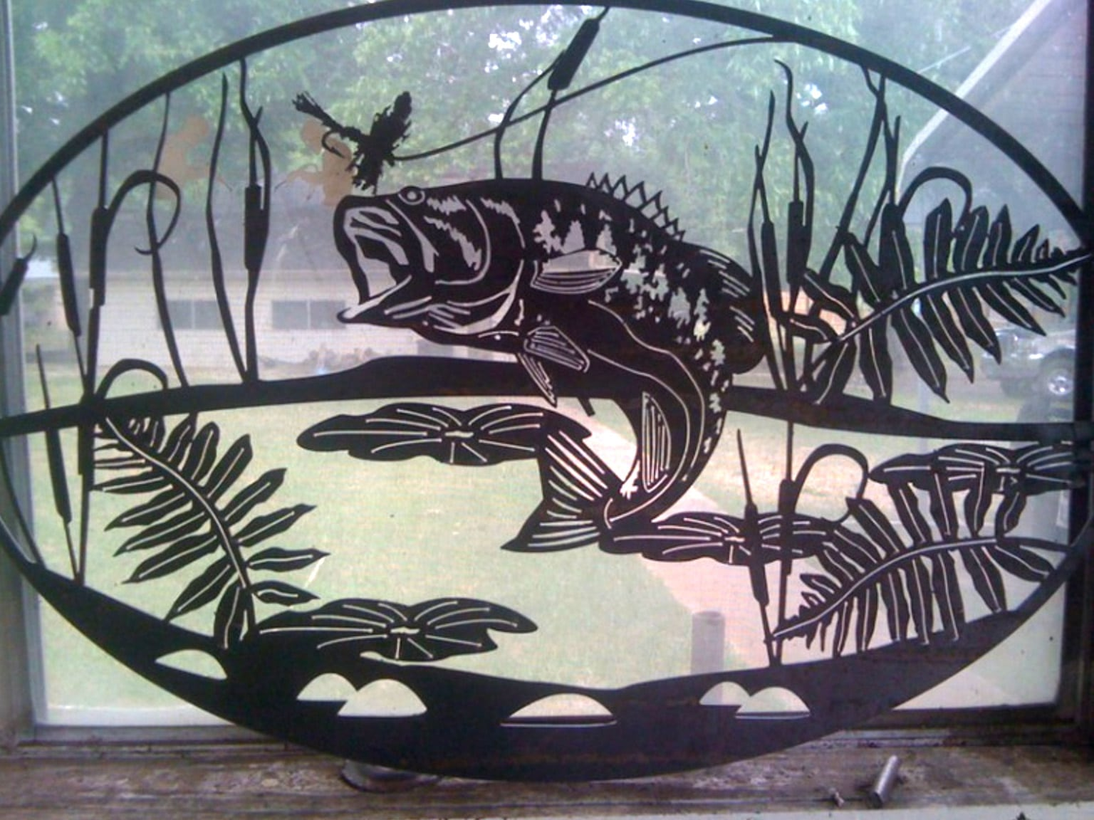 A customized steel sign including unique fish artwork