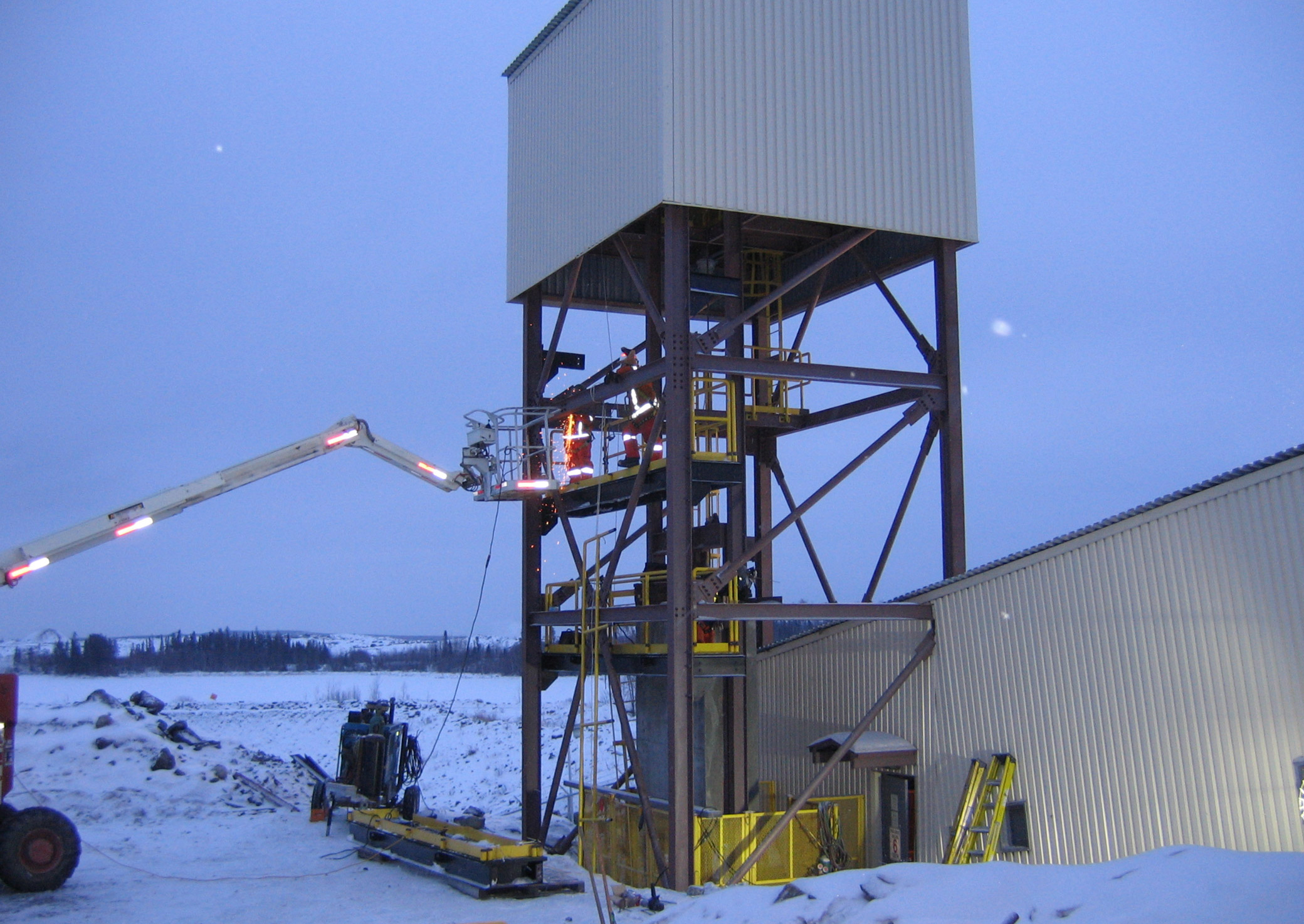 Take up tower fabricated and being installed in harsh winter conditions by Rector Machine Works