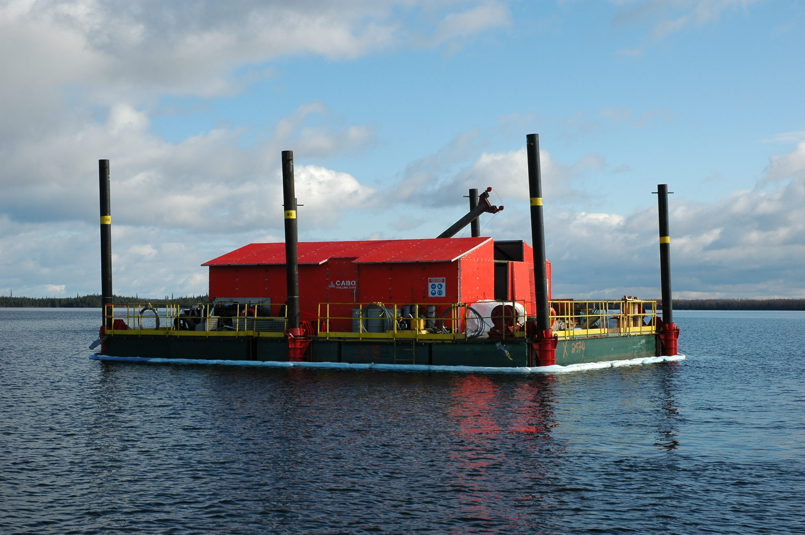 Mineral exploration drilling barge design and fabricated by Rector used in Northwestern Ontario